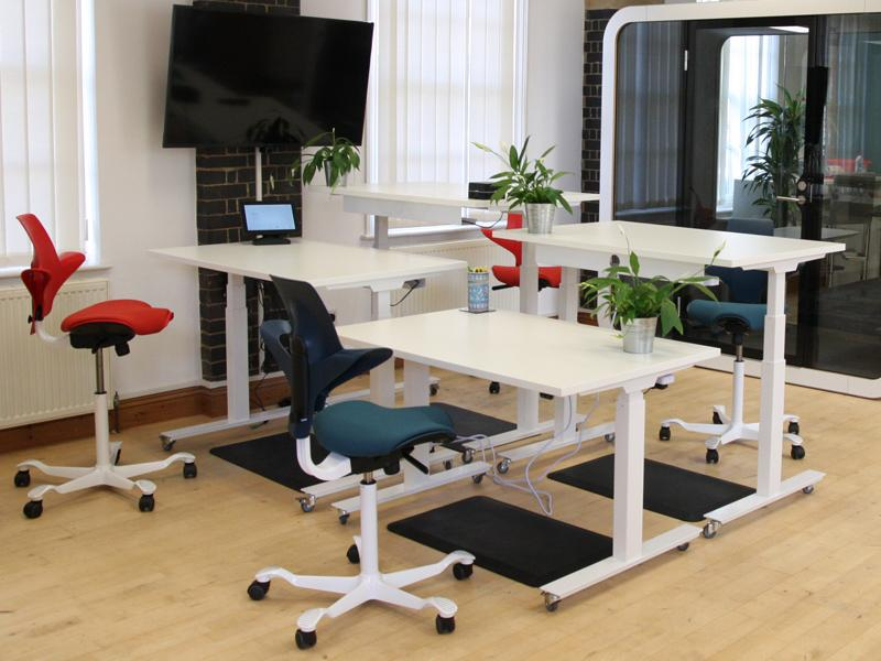 Metal Cable trays and standing desks from flomotion