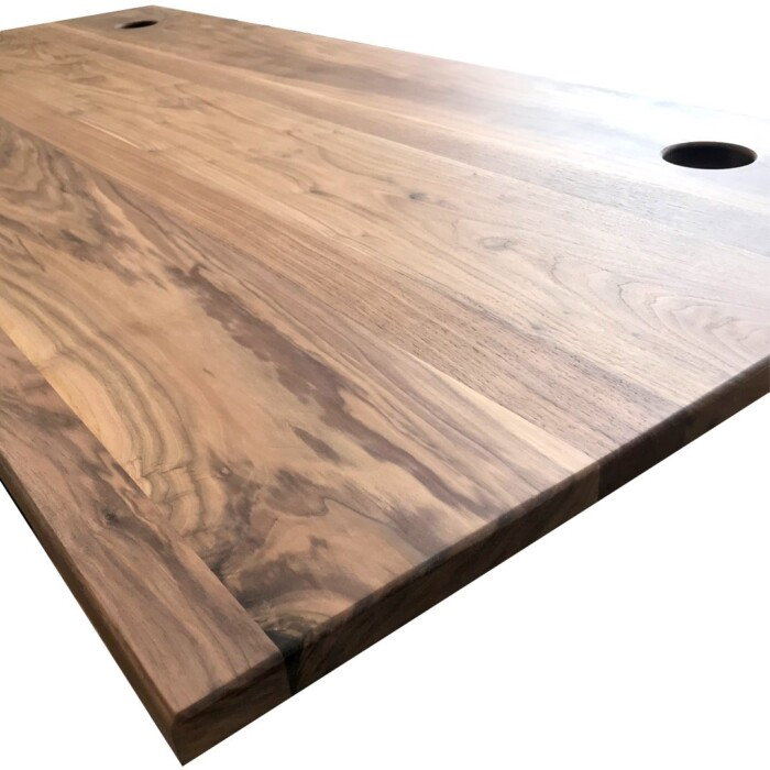 Solid walnut desktop with cable ports for the Skyflo standing desk